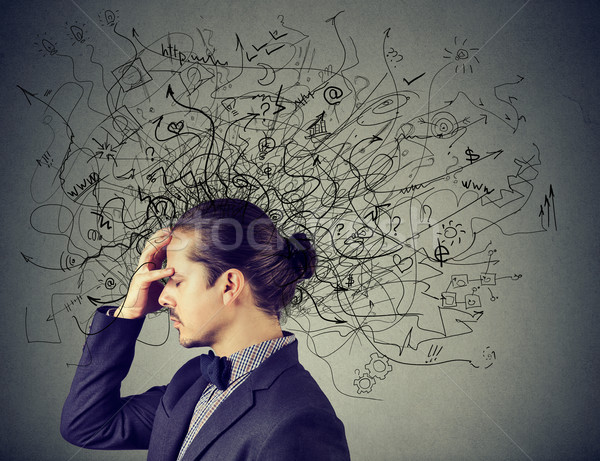 Thoughtful stressed young man with a mess in his head Stock photo © ichiosea