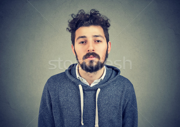 Stock photo: Unmotivated lazy young man on gray