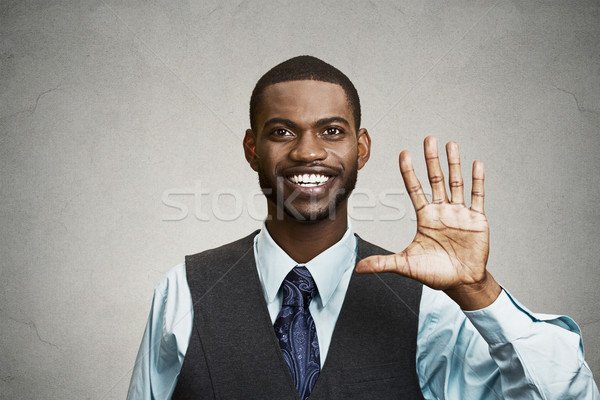 Happy man giving five times gesture with hand Stock photo © ichiosea
