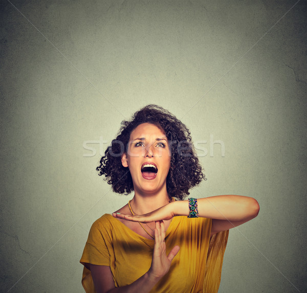Young woman showing time out hand gesture, frustrated screaming Stock photo © ichiosea