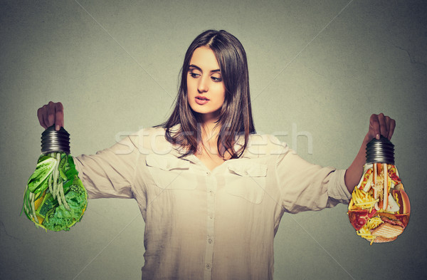 Woman thinking making diet choices junk food or green vegetables Stock photo © ichiosea