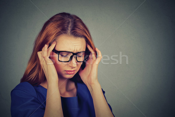 sad young woman in glasses with worried stressed face expression  Stock photo © ichiosea