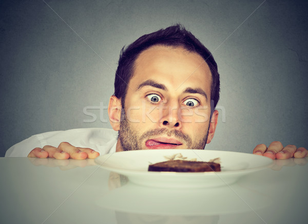 Hungry man craving sweet food  Stock photo © ichiosea