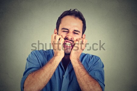disgusted man pinches nose disgusted something stinks bad smell Stock photo © ichiosea