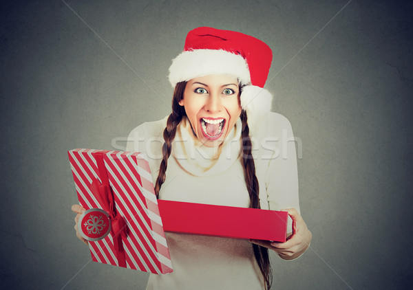 excited woman wearing red santa claus hat opening gift box  Stock photo © ichiosea