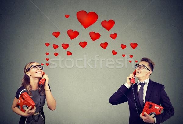 Pár szeretet romantikus telefon párbeszéd fiatal pér Stock fotó © ichiosea