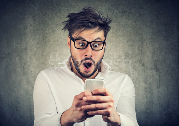 Shocked man having great news on phone Stock photo © ichiosea