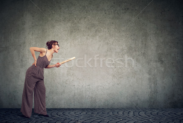 Angry young woman with rolling pin screaming Stock photo © ichiosea