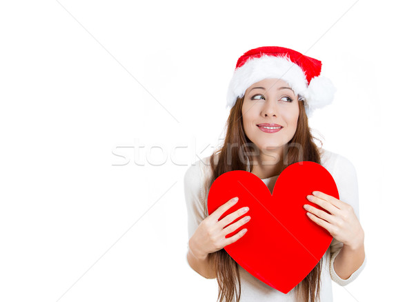 Beautiful, adorable christmas woman in love, holding a big heart Stock photo © ichiosea