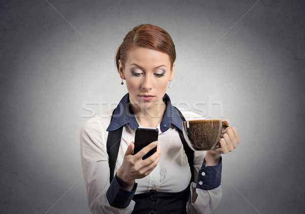 Woman reading bad news on smartphone drinking coffee  Stock photo © ichiosea