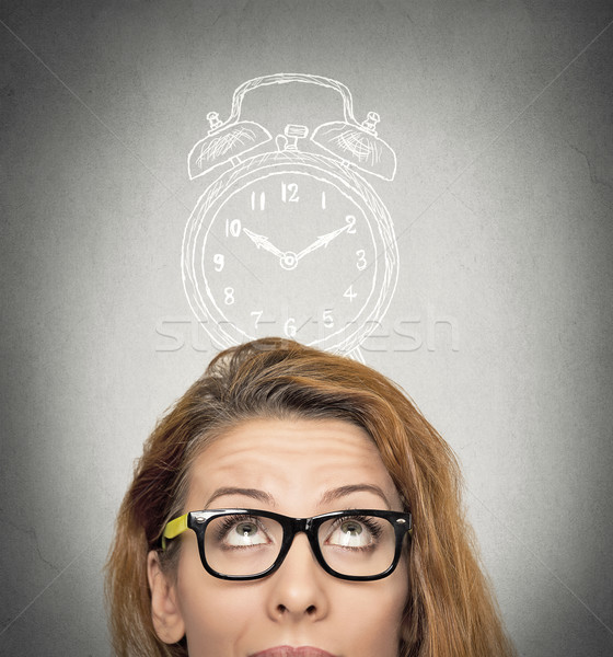 business woman with alarm clock above her head Stock photo © ichiosea