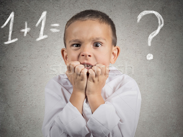 Confused, anxious boy trying to solve math problem Stock photo © ichiosea