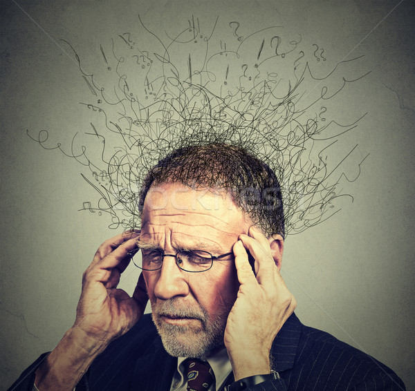 senior elderly man with worried stressed face expression looking down  Stock photo © ichiosea
