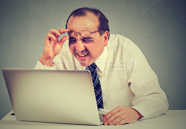 business man with glasses having eyesight problems confused with laptop software Stock photo © ichiosea