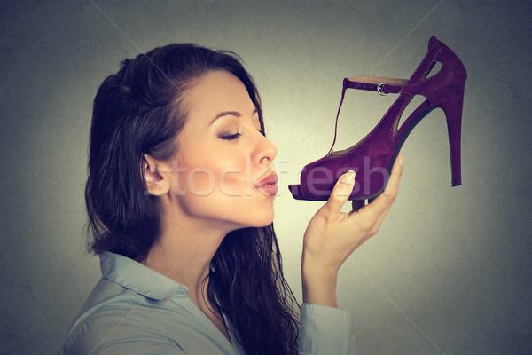 Side profile woman kissing high heel shoe Stock photo © ichiosea