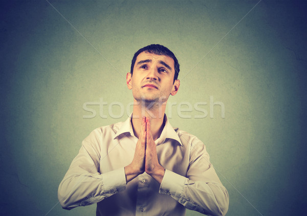Closeup portrait young man praying hands clasped Stock photo © ichiosea