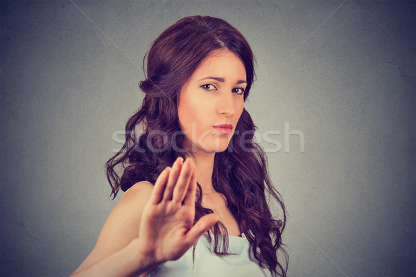 young annoyed angry woman with bad attitude giving talk to hand gesture  Stock photo © ichiosea