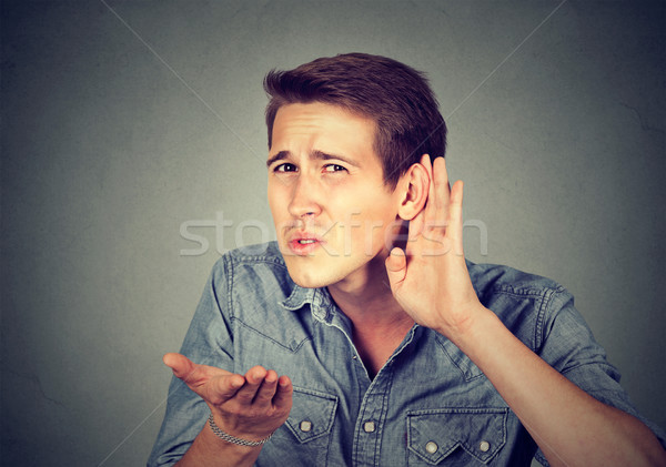 hard of hearing man placing hand on ear asking someone to speak up  Stock photo © ichiosea