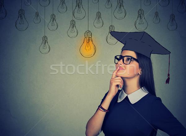 Zamyślony student kobieta cap suknia Zdjęcia stock © ichiosea