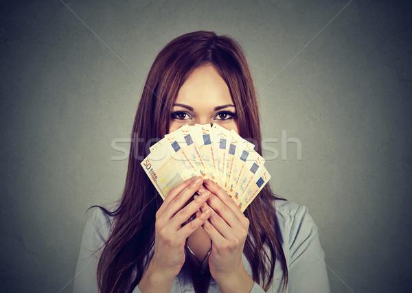 woman hiding her face behind euro money fan Stock photo © ichiosea