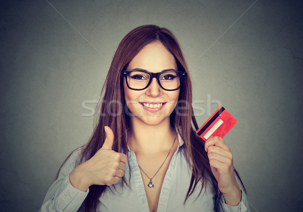 woman with credit card giving thumbs up hand gesture  Stock photo © ichiosea