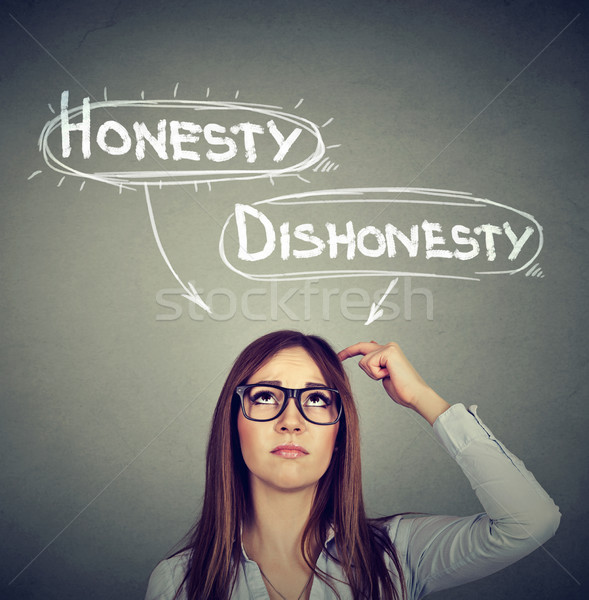 Woman making a decision honesty vs dishonesty   Stock photo © ichiosea