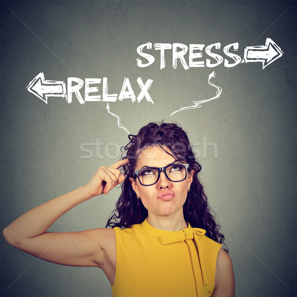 Stress or relax. Confused skeptical woman thinking looking up  Stock photo © ichiosea