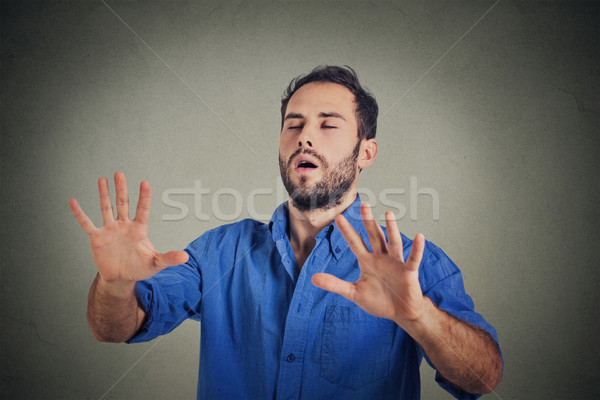 Stock photo: Man with eyes closed searching something
