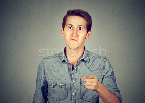 angry man pointing his finger accusing someone  Stock photo © ichiosea