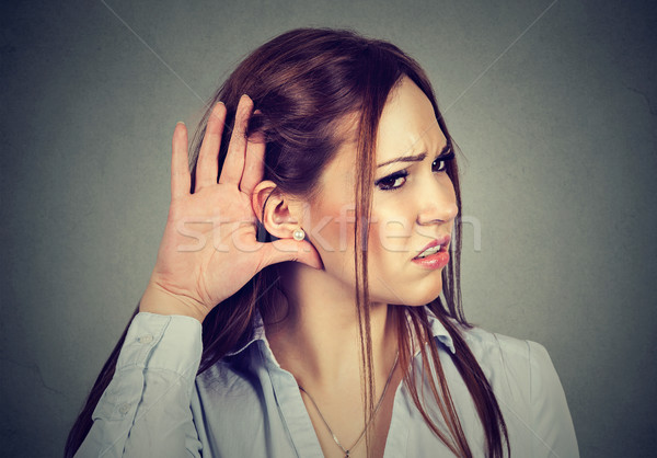 Curious worried woman with hand to ear listening to gossip  Stock photo © ichiosea