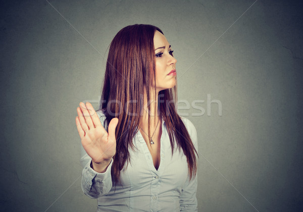 annoyed angry woman giving talk to hand gesture Stock photo © ichiosea