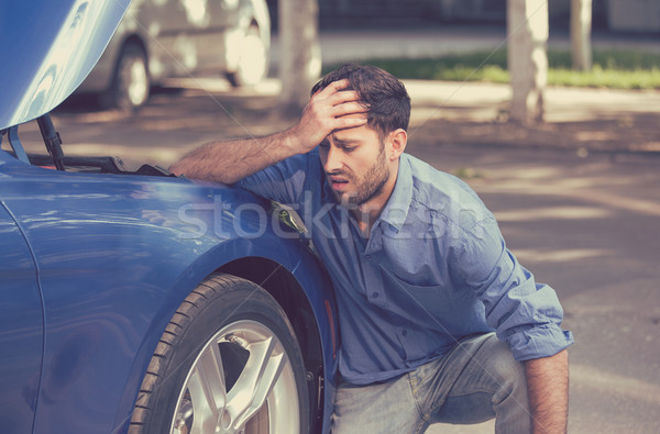 Man with broken down car flat tire in the middle of the street Stock photo © ichiosea