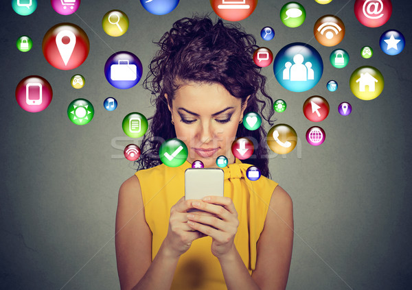 Happy young woman using texting on smartphone  Stock photo © ichiosea