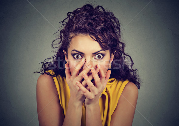 Scared shocked woman with hands over her mouth  Stock photo © ichiosea