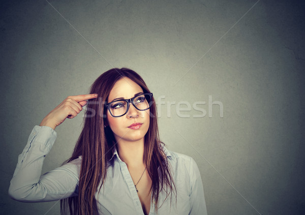 confused thinking woman bewildered scratching head seeks a solution  Stock photo © ichiosea