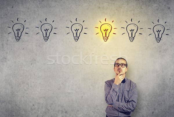 Man contemplating on creative ideas Stock photo © ichiosea