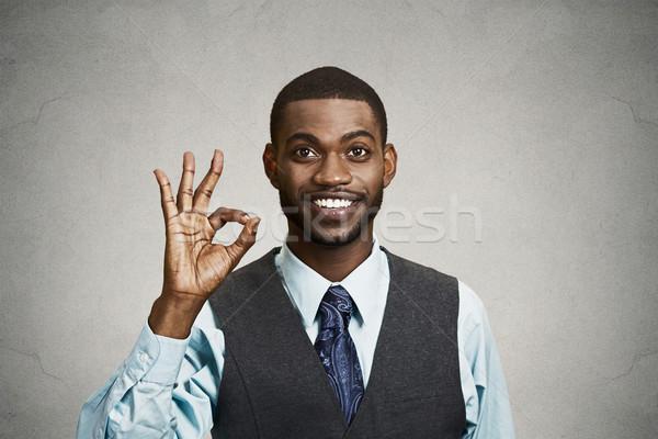 Hombre de negocios signo primer plano retrato jóvenes Foto stock © ichiosea
