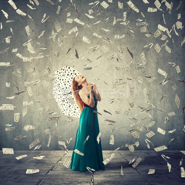 Heureux femme parapluie argent pluie excité Photo stock © ichiosea
