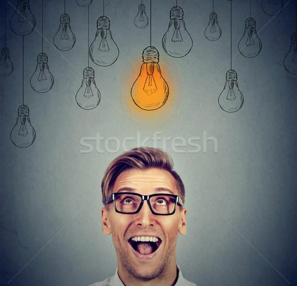 Opgewonden man bril licht idee lamp Stockfoto © ichiosea