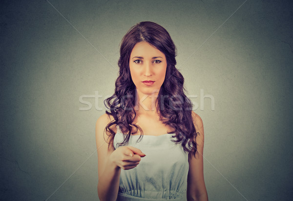 Serious young woman pointing at camera  Stock photo © ichiosea