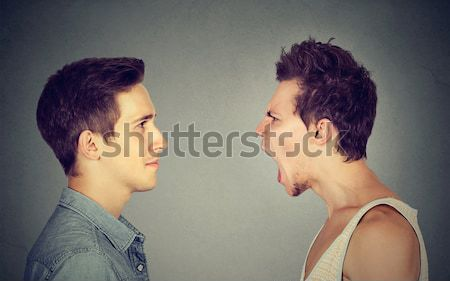 Angry young couple screaming face to face. Stock photo © ichiosea