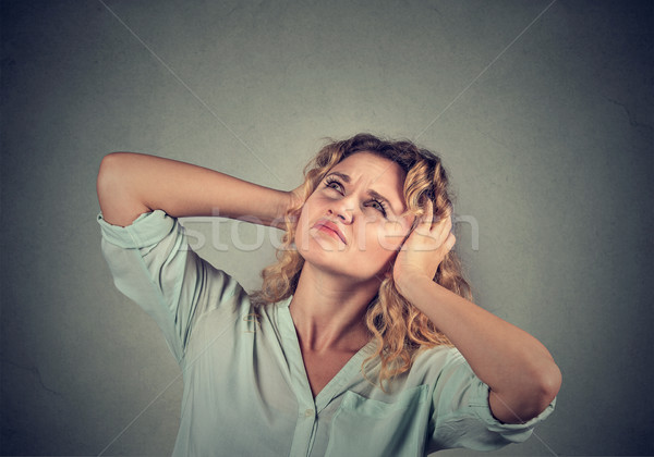 annoyed, unhappy, stressed woman covering her ears, looking up Stock photo © ichiosea