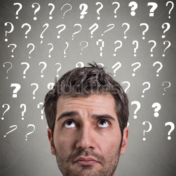 Curioso hombre pensando muchos preguntas Foto stock © ichiosea