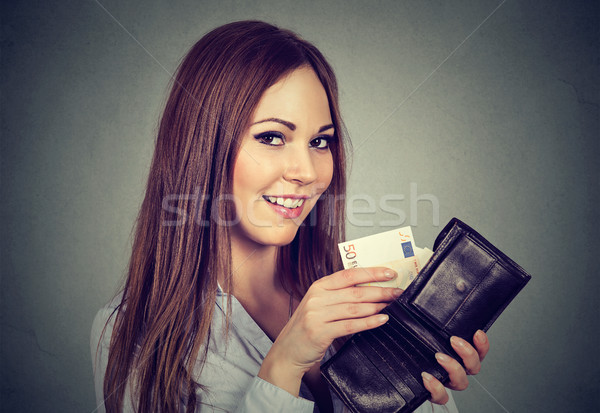 Woman taking out money euro banknotes from wallet  Stock photo © ichiosea