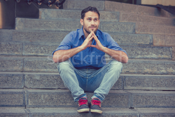 Daydreaming man sitting outdoors on steps  Stock photo © ichiosea