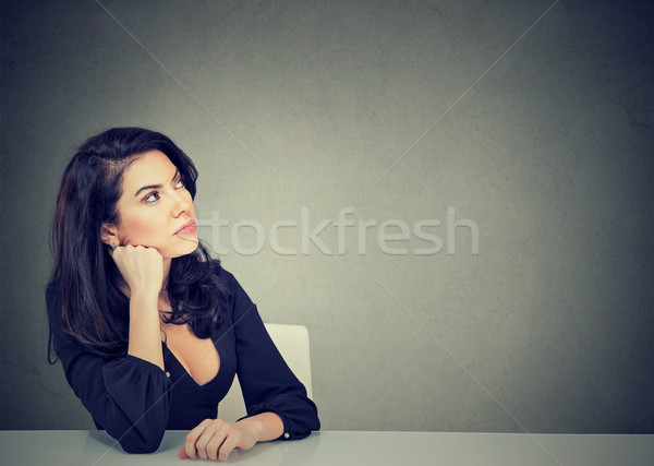 Thinking business woman sitting at desk  Stock photo © ichiosea