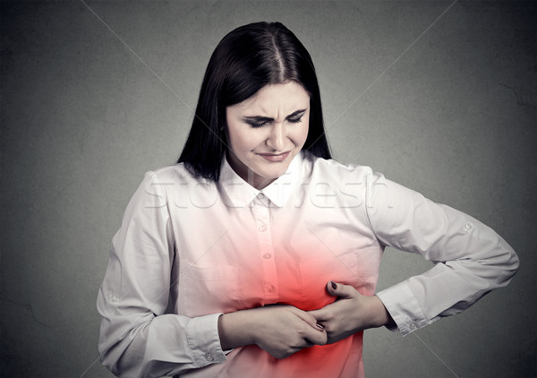 sick woman with heart attack, pain, touching her chest colored in red with hands Stock photo © ichiosea