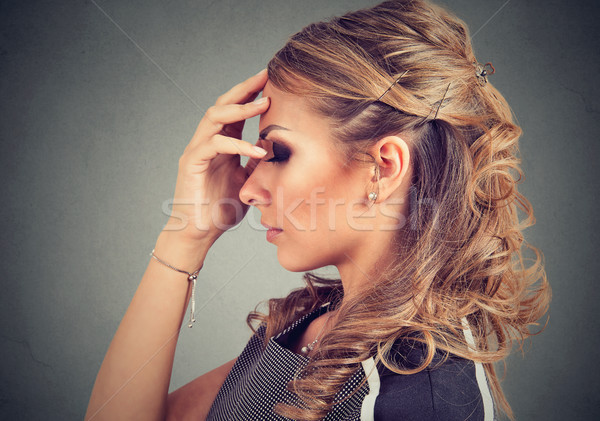 Serious young woman thinking very hard Stock photo © ichiosea
