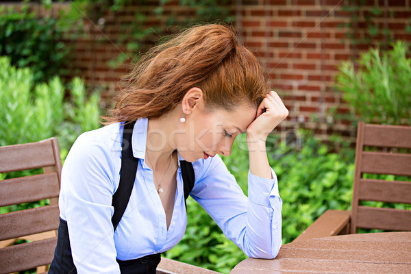 Depressed businesswoman Stock photo © ichiosea