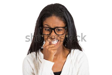 nervous woman with glasses biting her fingernails  Stock photo © ichiosea